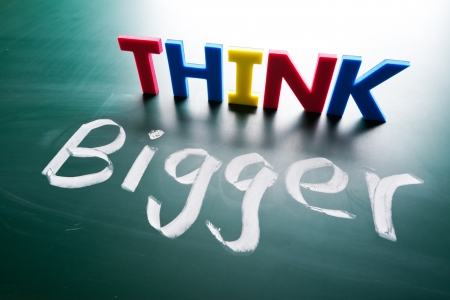 Think bigger concept, words on blackboard Stock Photo - 16437157