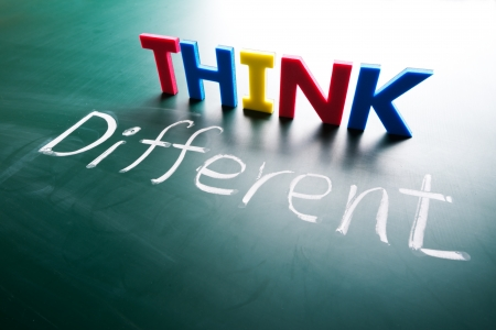 Think different concept, words on blackboard