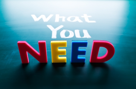 need: What you need concept, words on blackboard Stock Photo