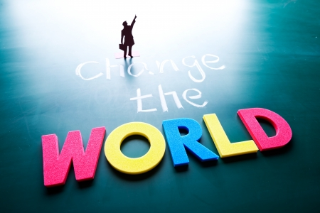 Change the world concept, man and words on blackboard Stock Photo - 17200805