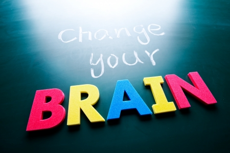 business change: Change your brain concept, words on blackboard Stock Photo