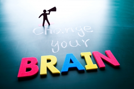 Change your brain concept, man and words on blackboard Stock Photo - 17478322