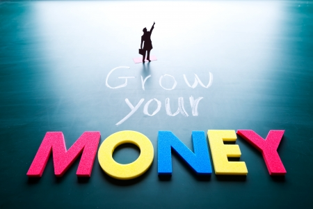 grow money: Grow your money concept, man and words on blackboard