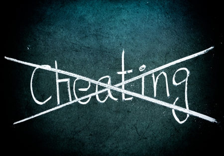 cheating: No cheating concept, words on grungy blackboard Stock Photo