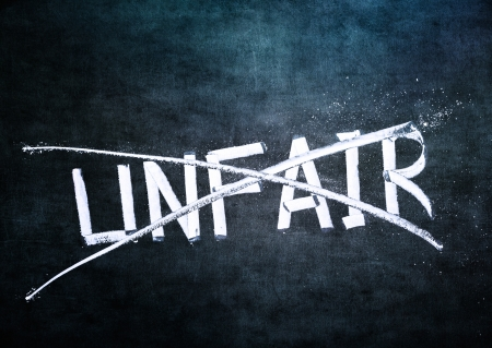 unfair: No unfair concept, word on grungy blackboard