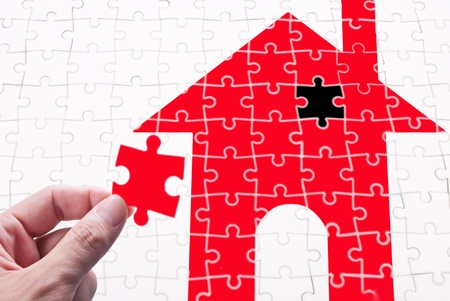 get in shape: Get your house concept  Finish the goal of own a house  human hand with puzzle piece