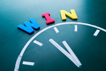 Time to win concept, color word and clock on blackboard Stock Photo - 17711380