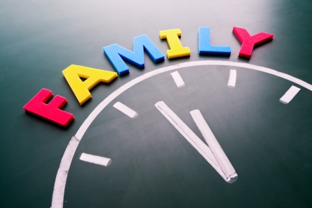 Time for family concept, color word and clock on blackboard photo