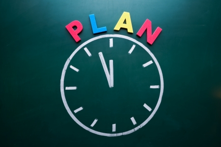 strategizing: Time to plan concept, color word and clock on blackboard Stock Photo