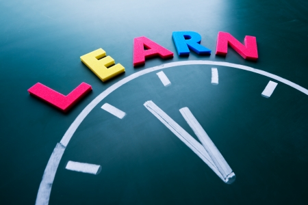 session: Time to learn concept, color word and clock on blackboard Stock Photo