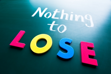 Nothing to lose, conceptual words on blackboard Stock Photo - 18222006