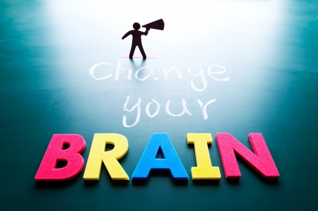 Change your brain concept, man and words on blackboard photo