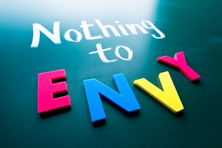 nothing: Nothing to envy, conceptual words on blackboard