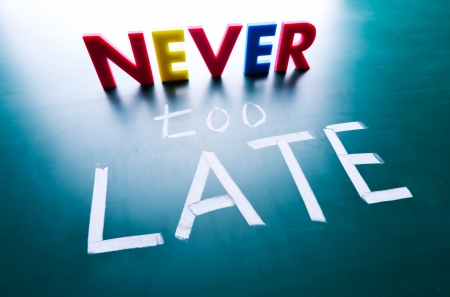 too late: Never too late concept, words on blackboard