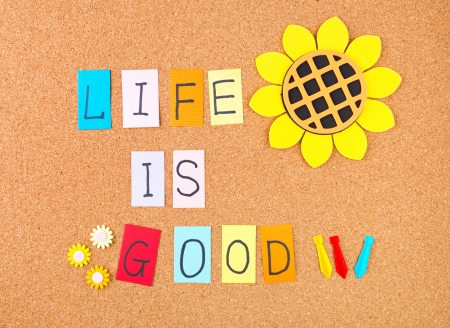 good feeling: Life is good, conceptual words with decoration on cork Stock Photo