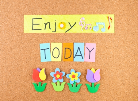 today: Enjoy today, conceptual words with decoration on cork Stock Photo