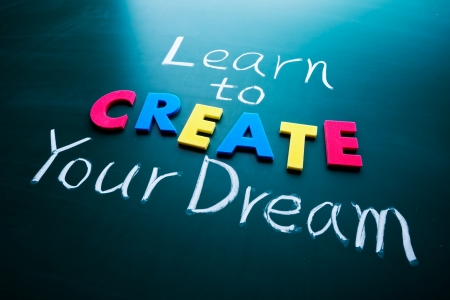 Learn to create your dream, color words on blackboard photo