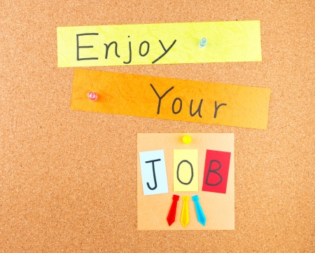 Enjoy your job, conceptual words with decoration on cork Stock Photo - 18551594
