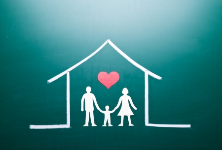 Family in a house, drawing on blackboard Stock Photo - 18551585