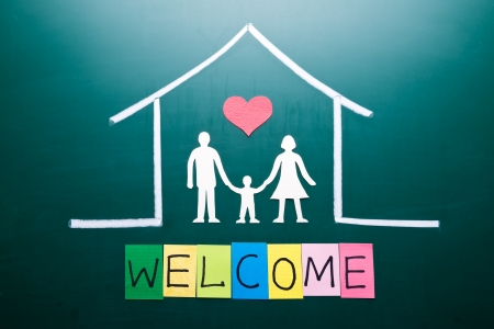 welcome home: welcome word and Family in house, drawing on blackboard