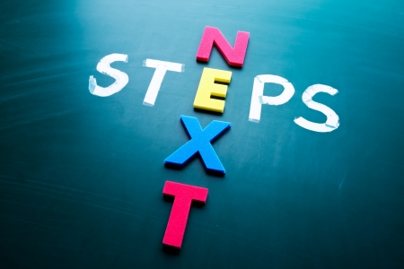 Next steps concept, words on blackboard Stock Photo
