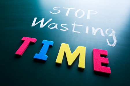 Stop wasting time concept, colorful words on blackboard photo