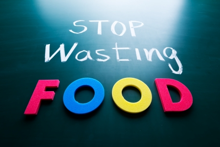 Stop wasting food concept, colorful words on blackboard photo
