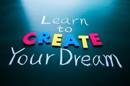 toward: Learn to create your dream, words on blackboard