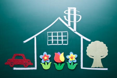 sold small: Wealth concept  Money sign on drawing house on blackboard  Handmade car, tree and flowers as decoration  Stock Photo