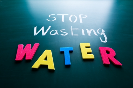 Stop wasting water concept, colorful words on blackboard photo