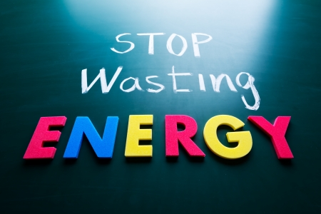 energy save: Stop wasting energy concept, colorful words on blackboard