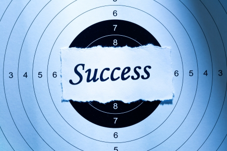 Success concept, word on target paper photo