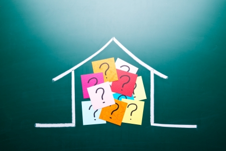 housing problems: Color question mark in drawing house on blackboard