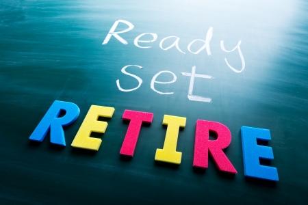 retire: Ready, set, retire! Colorful conceptual words on blackboard.