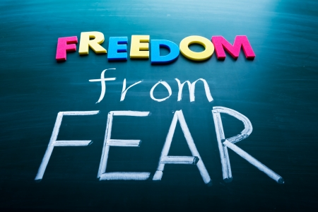 Freedom from fear, colorful conceptual words on blackboard.  Stock Photo
