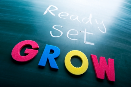 Ready, set, grow! Colorful conceptual words on blackboard.  photo