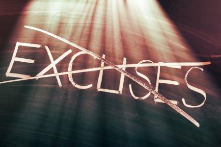 excuse: No excuses concept, conceptual words on blackboard