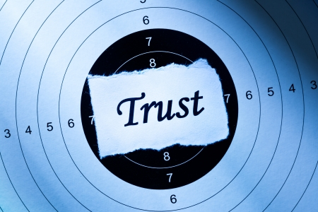 axiom: Trust concept, word on target paper Stock Photo