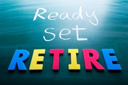 retirement money: Ready, set, retire! Colorful conceptual words on blackboard.