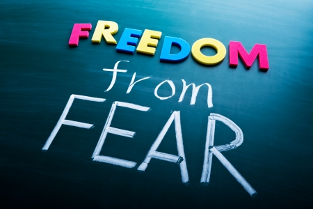 stress free: Freedom from fear, colorful conceptual words on blackboard.  Stock Photo