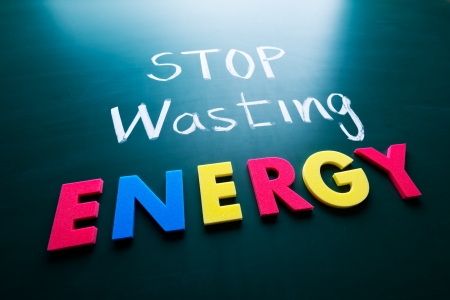 nuclear energy: Stop wasting energy concept, colorful words on blackboard