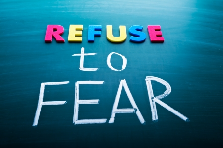 no fear: Refuse to fear, colorful conceptual words on blackboard.