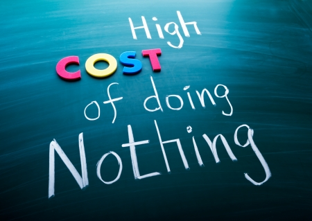 High cost of doing nothing, conceptual words on blackboard