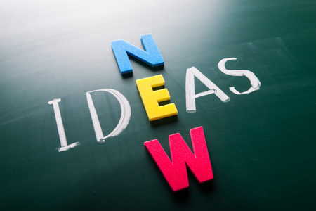 conceptual ideas: New ideas, words on blackboard with colorful alphabets. Stock Photo