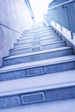 Long stairs up to modern building with sunshine photo