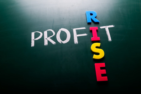 Profit rise business concept, words on blackboard photo