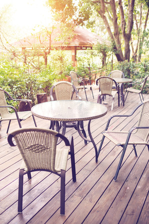 restaurant exterior: Tables and chairs of cafeteria outside in garden