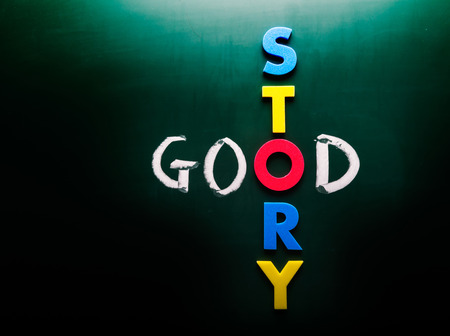 anecdote: Simple Good Story Concept with Colored STORY Letters Crossing GOOD Text on Dark Green Chalkboard. Stock Photo