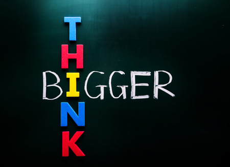 counsel: Simple Think Bigger Concept, with Colorful THINK Letters Crossing on BIGGER Text at Green Chalkboard