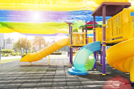 playground equipment: The colorful playground for kids at the park Stock Photo